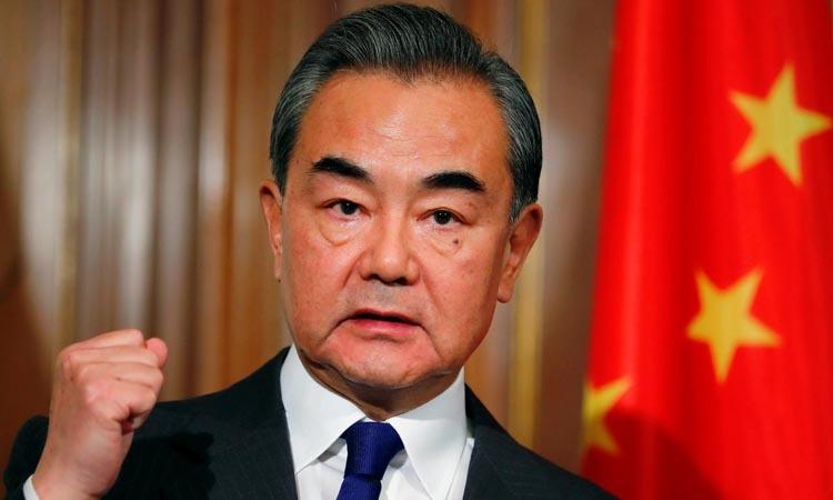 Ngoại trưởng Trung Quốc Vương Nghị trong cuộc họp báo tại Berlin, Đức hôm 13/2. Ảnh: Reuters.