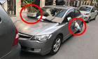 Tài xế thấy rác treo đầy xe khi đỗ ôtô không quan sát