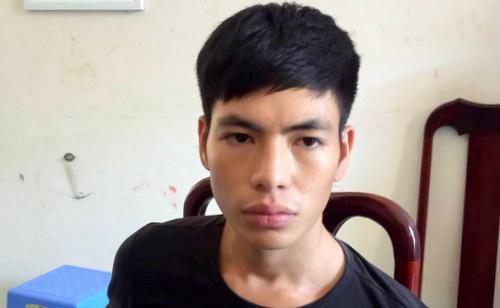 Nguyễn Văn Tuấn tại cơ quan công an. Ảnh: Quang Bình.