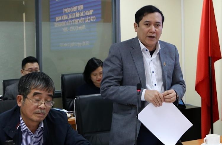 Phó Viện trưởng Viện Khoa học tổ chức nhà nước Lê Anh Tuấn báo cáo tại Hội thảo của Bộ Nội vụ chiều 19/2. Ảnh: Anh Tuấn