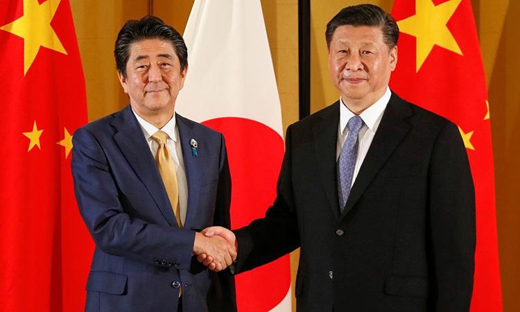 Thủ tướng Nhật Abe và Chủ tịch Trung Quốc Tập Cận Bình tại Thượng đỉnh G20 ở Osaka, Nhật Bản tháng 6/2019. Ảnh: Reuters.