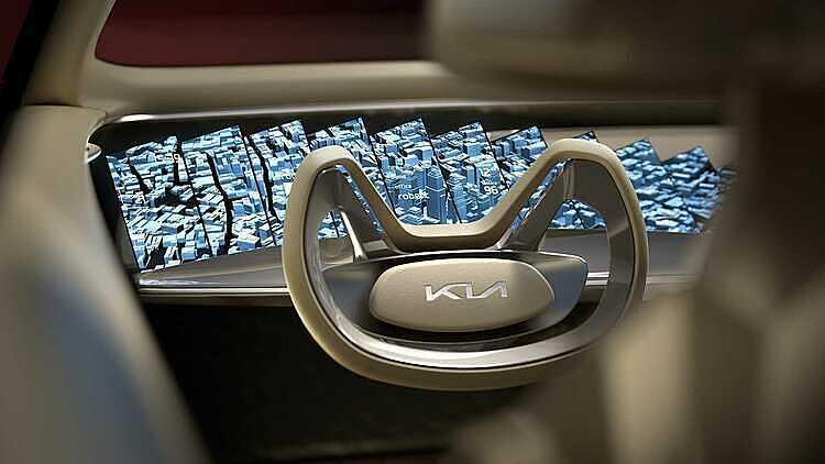 Logo Kia mới trên vô-lăng mẫu concept Imagine. Ảnh: Kia