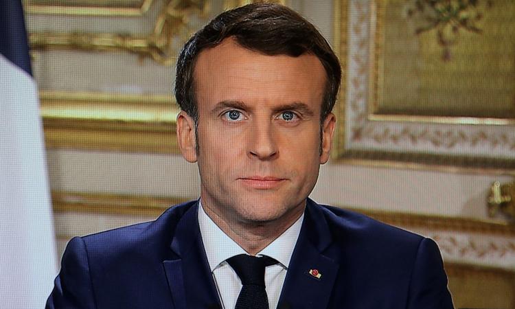 Tổng thống Pháp Emmanuel Macron trong bài phát biểu trên truyền hình quốc gia hôm 12/3. Ảnh: AFP.