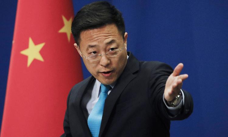 Phát ngôn viên Bộ Ngoại giao Trung Quốc Triệu Lập Kiên trong cuộc họp tại Bắc Kinh hôm 24/2. Ảnh: AP.