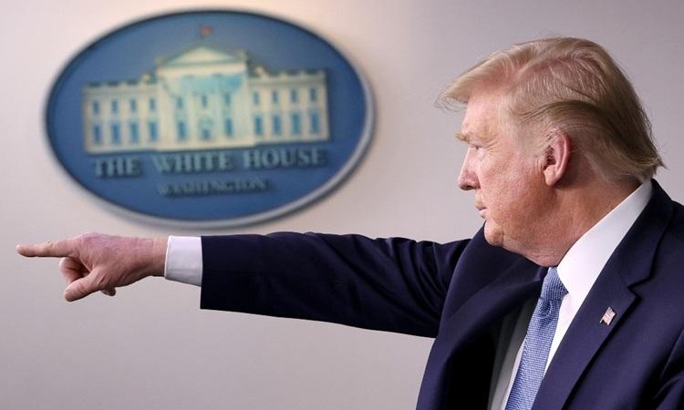 Tổng thống Mỹ Donald Trump tại buổi họp báo về Covid-19 ở Nhà Trắng hôm 16/3. Ảnh:AFP.