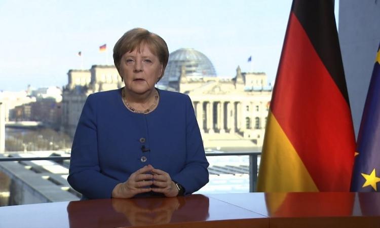 Thủ tướng Đức Angela Merkel phát biểu trên truyền hình hôm 18/3. Ảnh: AFP.