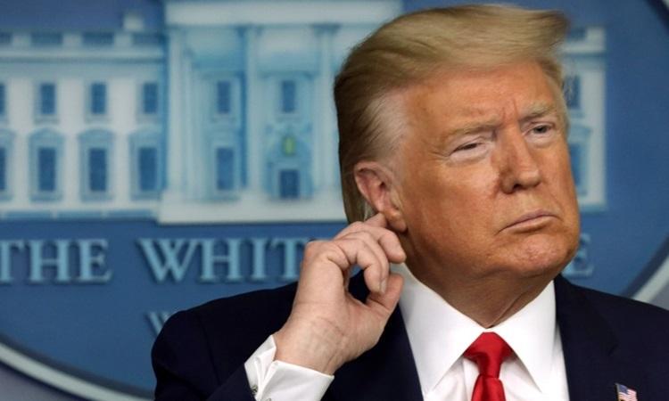 Tổng thống Mỹ DonaldTrump tại buổi họp báo Covid-19 ở Nhà Trắng hôm 18/3. Ảnh: AFP.