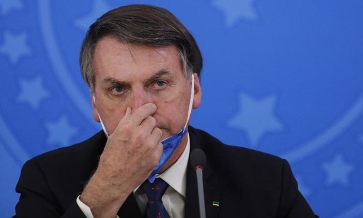 Tổng thống Brazil Jair Bolsonaro tại cuộc họp báo về Covid-19 ởBrasilia hôm 20/3. Ảnh: AFP.