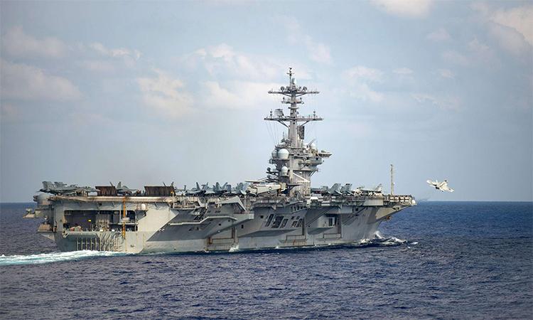 Tiêm kích F/A-18F Super Hornet cất cánh từ tàu sân bay USS Theodore Roosevelt ngày 18/3. Ảnh: US Navy.
