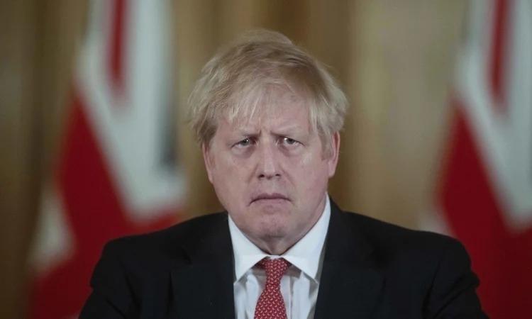 Thủ tướng Anh Boris Johnson trong cuộc họp báo ở London ngày 20/3. Ảnh: AFP.