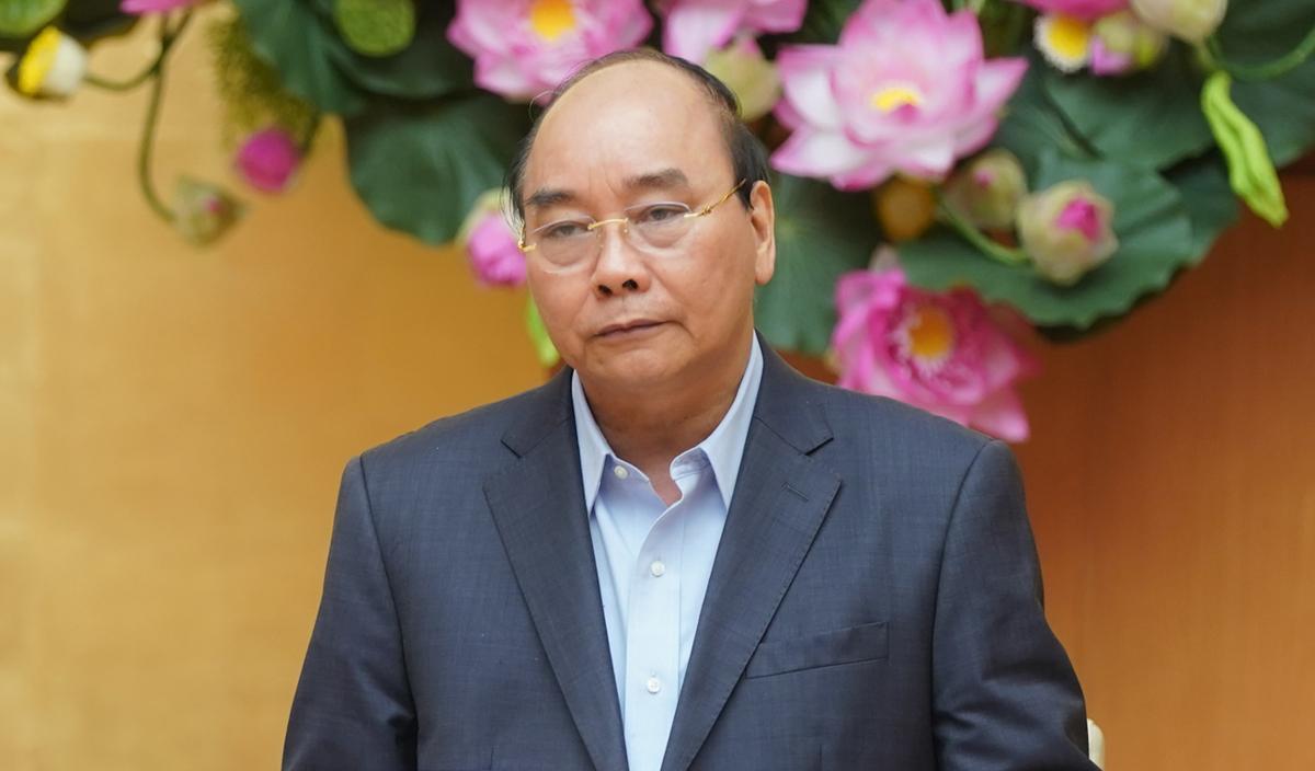 Thủ tướng Nguyễn Xuân Phúc chủ trì họp với các địa phương về chống Covid-19, sáng 29/3. Ảnh: VGP