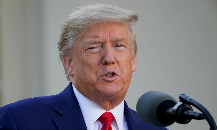 Tổng thống Trump trong cuộc họp báo tại Nhà Trắng hôm 30/3. Ảnh: AFP.