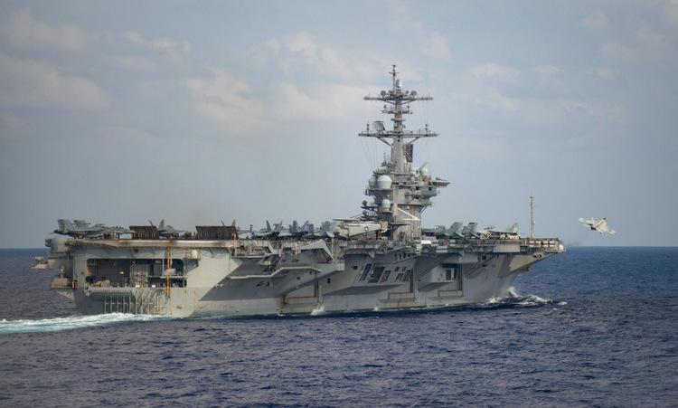 USS Theodore Roosevelt di chuyển trên Thái Bình Dương hôm 18/3. Ảnh: US Navy.