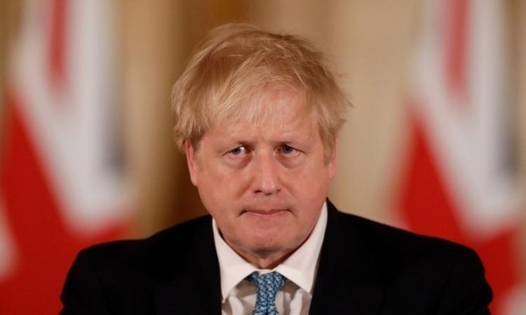 Thủ tướng AnhBoris Johnson tại cuộc họp báo ở London ngày 16/3. Ảnh:AFP.