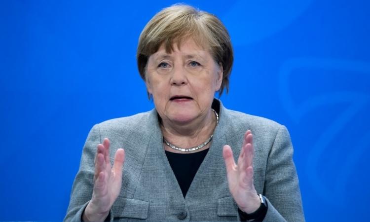 Thủ tướng Đức Angela Merkel phát biểu tại cuộc họp báo ở Berlin, hôm 15/4. Ảnh: AFP.