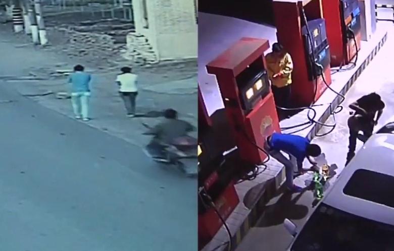 Hai thanh niên khả nghi vào mua xăng. Ảnh: CCTV.