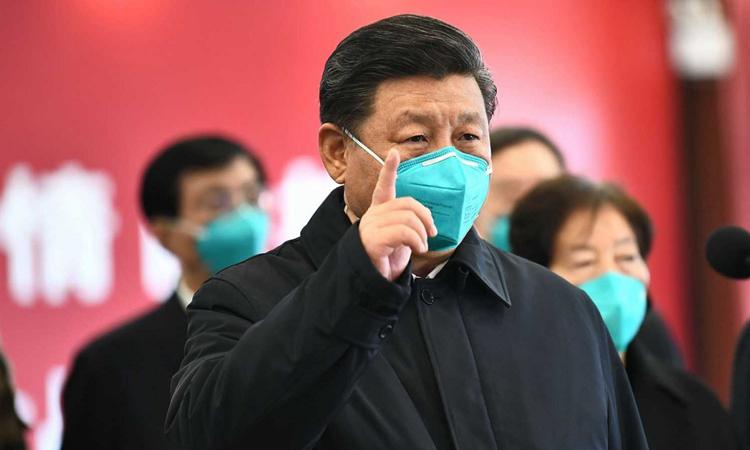 Chủ tịch Tập Cận Bình trong chuyến thăm thành phố Vũ Hán, hôm 10/3. Ảnh:Xinhua.
