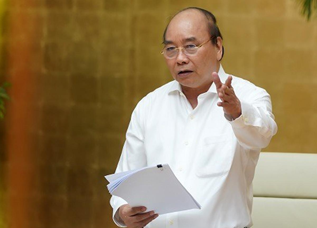 Thủ tướng Nguyễn Xuân Phúc làm việc trực tuyến với lãnh đạo chủ chốt của TPHCM hôm nay. Ảnh: VGP/Quang Hiếu