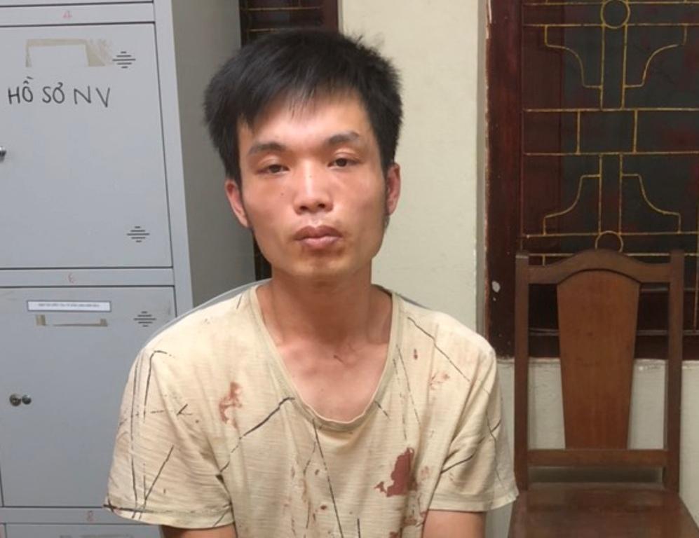 Ngô Quốc Việt tại cơ quan điều tra. Ảnh: Bình Minh