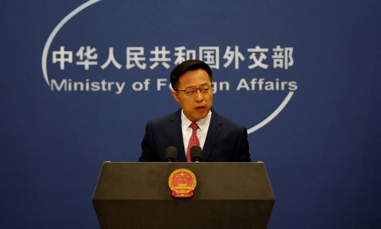 Phát ngôn viên Bộ Ngoại giao Trung Quốc Triệu Lập Kiên tại cuộc họp báo ở Bắc Kinh hôm 8/4. Ảnh: Reuters.