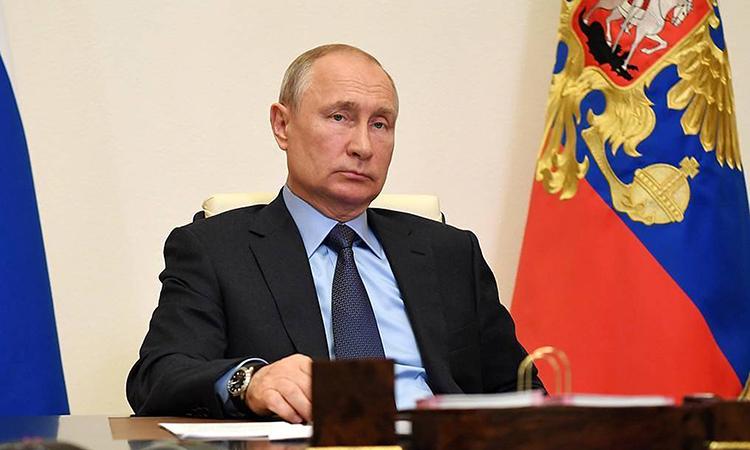 Tổng thống Nga Vladimir Putin trong cuộc họp trực tuyến với các quan chức tại dinh thự ở Novo-Ogaryovo, ngày 14/5. Ảnh:Điện Kremlin.