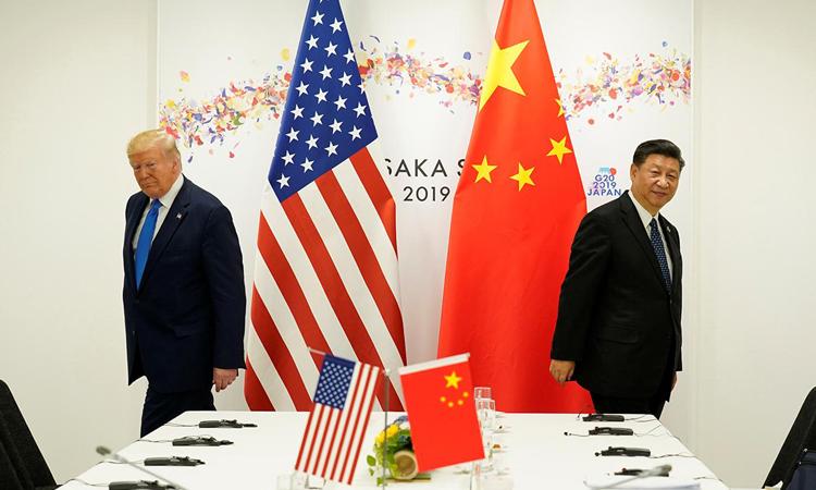 Tổng thống Donald Trump (trái) và Chủ tịch Tập Cận Bình tại hội nghị G20 ởOsaka, Nhật Bản, tháng 6/2019. Ảnh: Reuters.