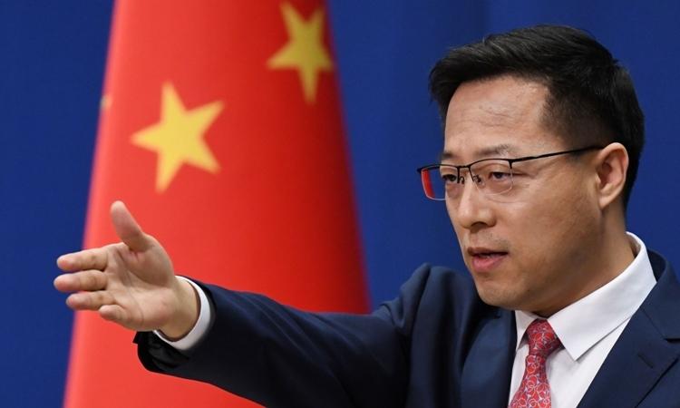 Phát ngôn viên Bộ Ngoại giao Trung Quốc Triệu Lập Kiên tại cuộc họp báo ở Bắc Kinh hôm 8/4. Ảnh: AFP.