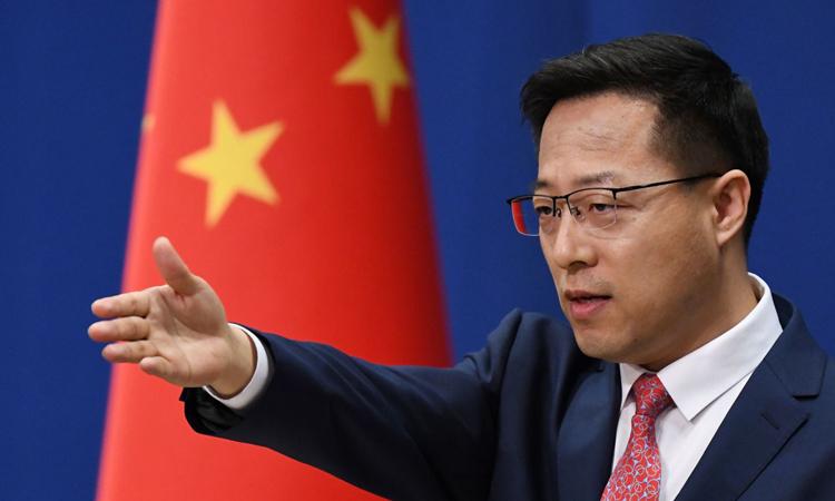 Người phát ngôn Bộ Ngoại giao Trung Quốc Triệu Lập Kiên trong cuộc họp báo tại Bắc Kinh, hồi tháng 4. Ảnh: AFP.