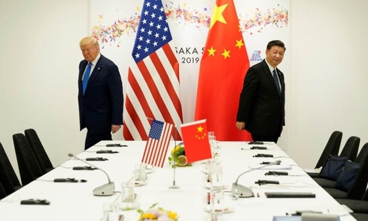 Tổng thống Mỹ Donald Trump (trái) và Chủ tịch Trung Quốc Tập Cận Bình tại cuộc gặp song phương bên lề hội nghị thượng đỉnh G20 ở Osaka, Nhật Bản, hồi năm ngoái. Ảnh: Reuters.