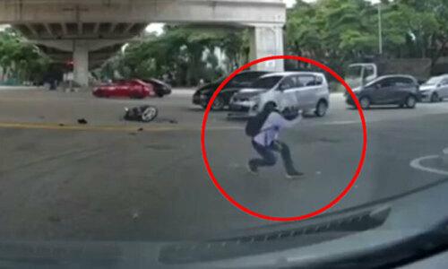Thanh niên dùng khinh công bay qua nóc ôtô sau va chạm - 1