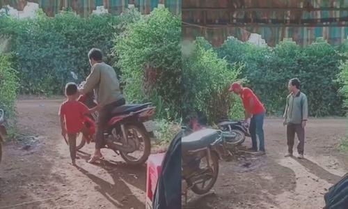 Ông chồng hú vía khi dắt xe giúp vợ - 2