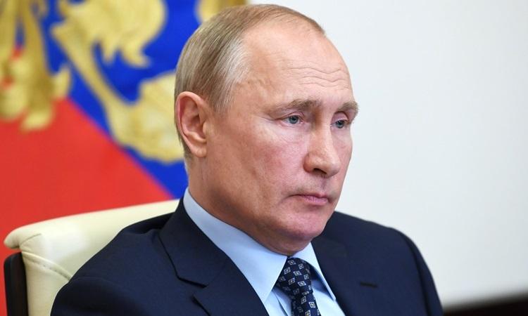 Tổng thống Nga Vladimir Putin trong cuộc họp qua video với các quan chức hàng đầu hôm 22/5. Ảnh: AFP.