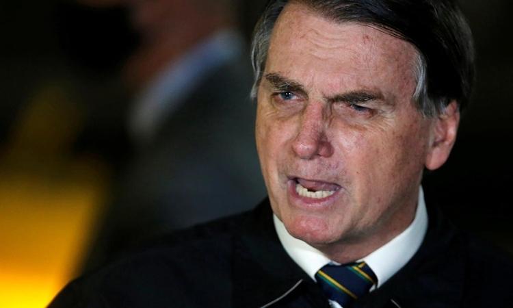 Tổng thống Brazil Jair Bolsonaro tại dinh Alvorada, Brasilia, hôm 22/5. Ảnh: Reuters.