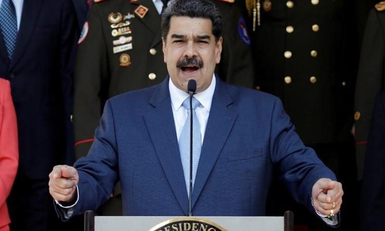 Tổng thống Venezuela Nicolas Maduro phát biểu trong một cuộc họp báo tại Cung điện Miraflores ở Caracas hôm 12/3. Ảnh: Reuters.