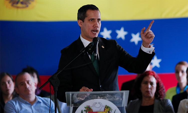 Lãnh đạo phe đối lập Juan Guaido phát biểu trong buổi hội thảo tại Caracas, Venezuela, ngày 9/3. Ảnh: Reuters.