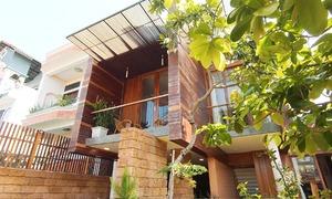 Hai năm phủ đá ong và gỗ cho căn nhà 135 m2