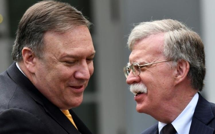 Ngoại trưởng Mỹ Mike Pompeo (trái) và cựu cố vấn an ninh quốc gia Mỹ John Bolton tại Nhà Trắng hồi tháng 6/2018. Ảnh: Reuters.
