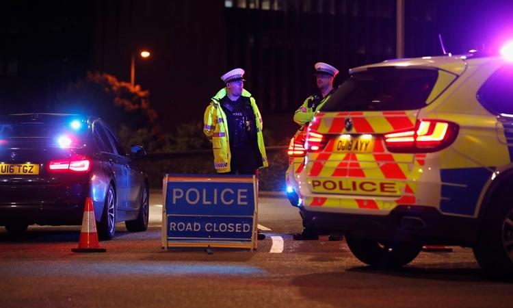 Cảnh sát phong tỏa con đường xảy ra đâm dao ởReading, Anh ngày 20/6. Ảnh: Reuters.