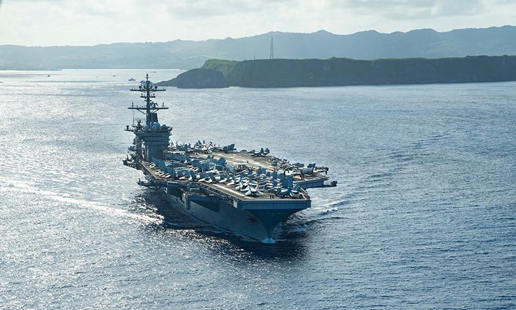 Tàu sân bay USS Theodore Roosevelt rời quân cảng trên đảo Guam để ra Biển Philippines làm nhiệm vụ, ngày 20/5. Ảnh: US Navy.