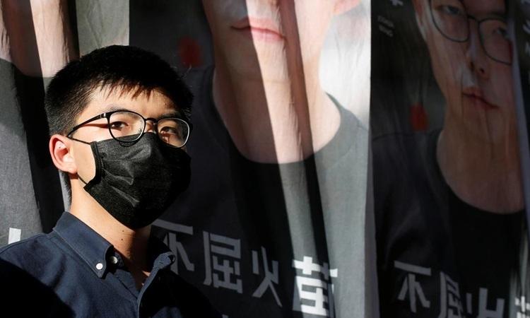 Nhà hoạt động dân chủ Hong Kong Joshua Wong thông báo kế hoạch tranh cử vào cơ quan lập pháp thành phố hôm 19/6. Ảnh: Reuters.