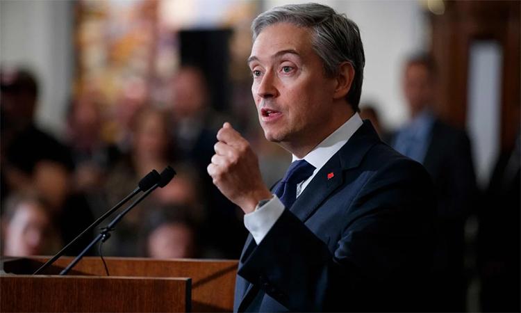 Ngoại trưởng Canada Francois-Philippe Champagne trong cuộc họp báo tại London, Anh, ngày 16/1. Ảnh: AFP.