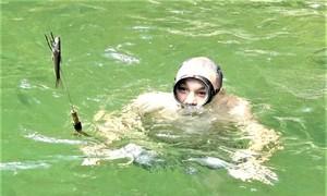 Lặn suối bắn cá