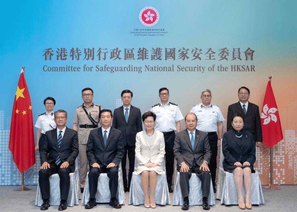 Các thành viên của ủy ban bảo vệ luật an ninh quốc gia Hong Kong trong phiên họp đầu tiên hôm 6/7. Ảnh: Xinhua.