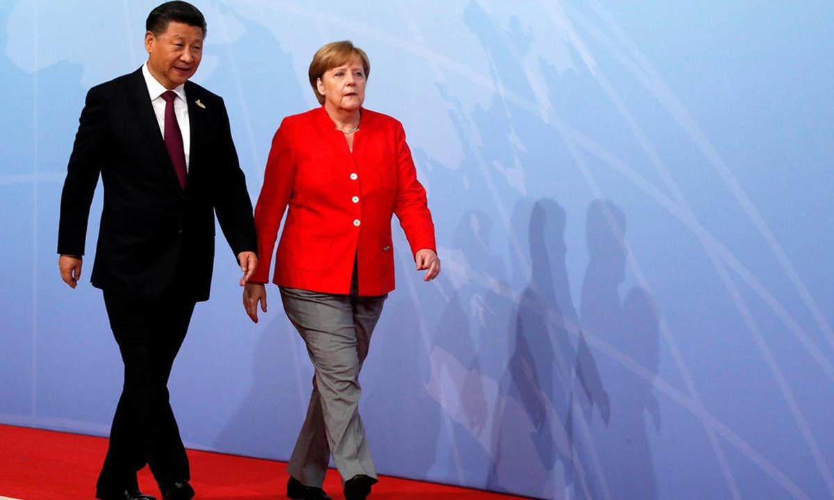 Chủ tịch Trung Quốc Tập Cận Bình (trái) và Thủ tướng Đức Angela Merkel tại hội nghị G20 ở Hamburg, Đức, hồi tháng 7/2017. Ảnh:Reuters.