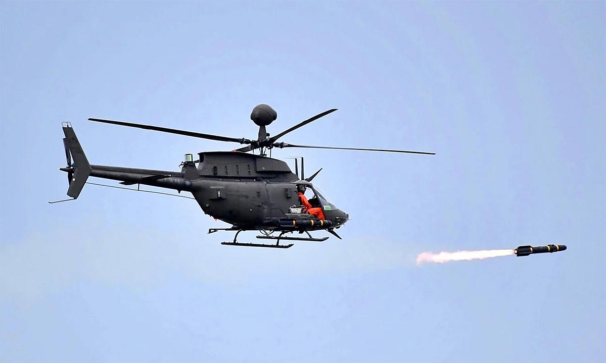 Trực thăng OH-58D tham gia diễn tập bắn đạn thật trên đảo Đài Loan, ngày 15/7. Ảnh: CNA.