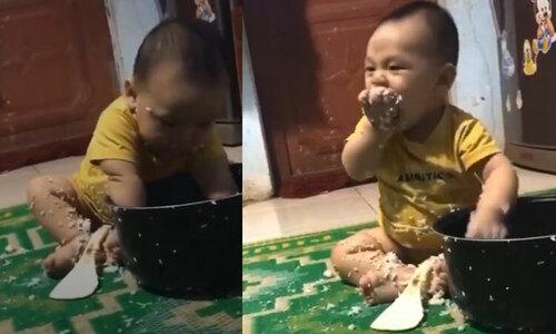 Cậu bé ăn vụng úp cả nồi cơm trên đầu - 2