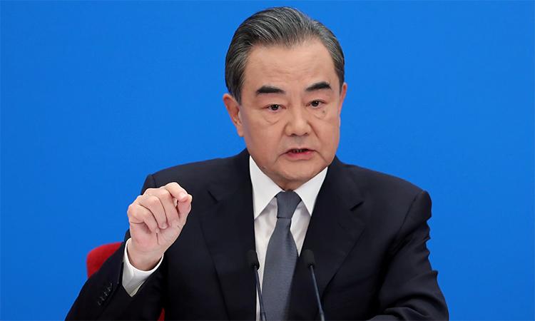 Ngoại trưởng Trung Quốc Vương Nghị trong cuộc họp báo tại Bắc Kinh, ngày 24/5. Ảnh: Reuters.