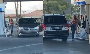 Cô gái loay hoay lái xe quanh cây xăng