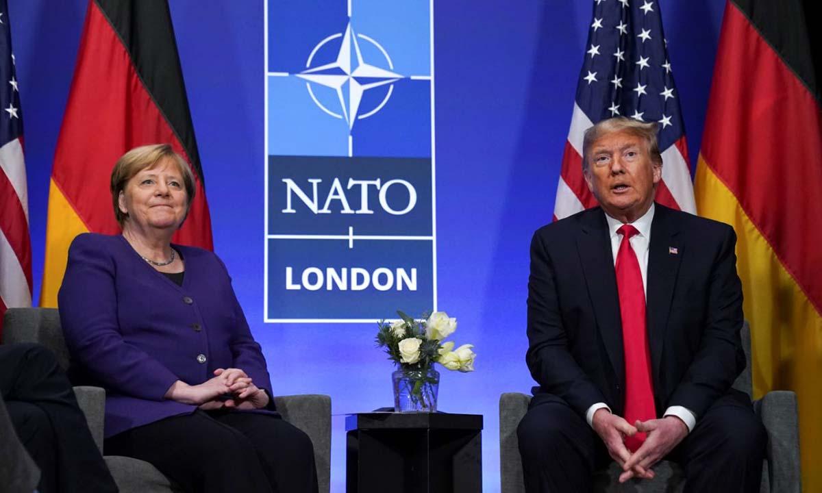 Thủ tướng Đức Angela Merkel (trái) và Tổng thống Mỹ Donald Trump tại cuộc họp bên lề hội nghị thượng đỉnh NATO ở Anh hồi tháng 12/2019. Ảnh: Reuters.