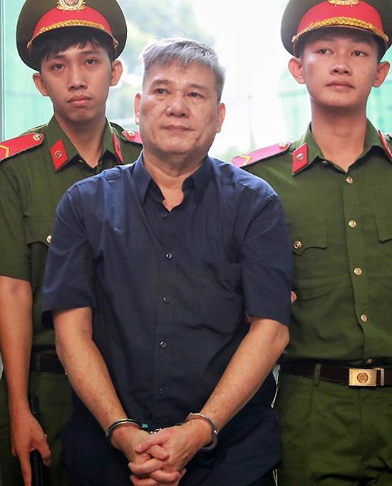 Bị cáo Dương Thanh Cường được đưa đến tòa hôm 23/7. Ảnh: Hữu Khoa.